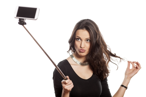pretty-brunette-making-selfie-with-a-stick