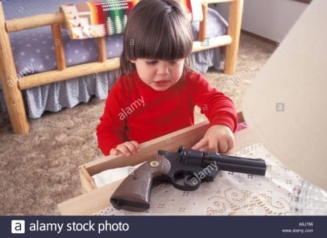 little-girl-finding-a-gun-A6J766